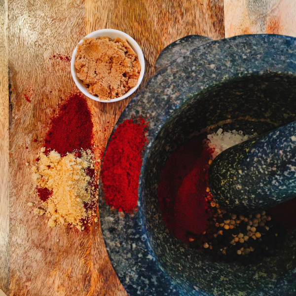 Collections of spices and mortar and pestle