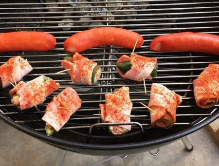 Bacon wrapped jalapenos on the Weber